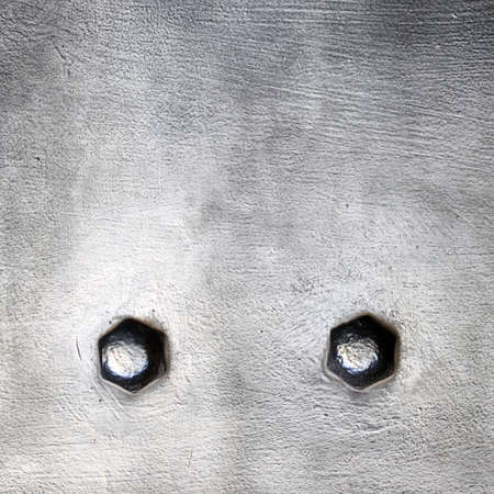 armoring: Black grunge metal plate or armour texture with rivets as background Stock Photo