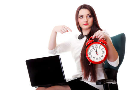 mmc: Young business woman with red clock white background. Deadline time management concept Stock Photo