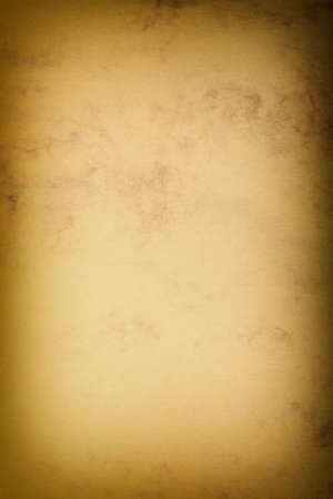 Vintage poster paper texture with a glowing center and grunge vignette abstract background photo