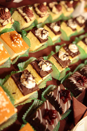 Varieties of cakes individual decorative desserts on the table at a luxury event, gourmet catering sweets Stock Photo - 19366973