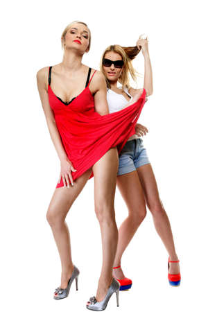 Full length two beautiful sexy crazy women in summer clothes. Studio portrait. photo