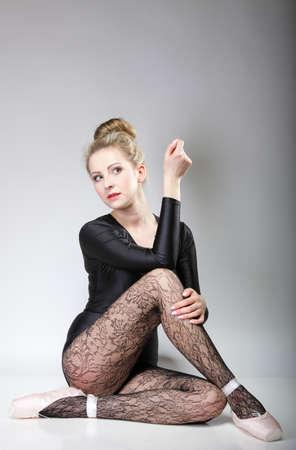 modern style beautiful woman ballet dancer full length in studio gray background photo