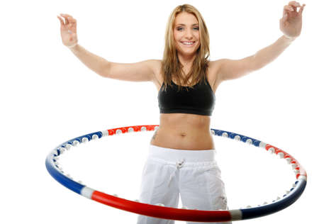 young sporty girl doing exercise with hula hoop. Fitness woman isolated on white photo