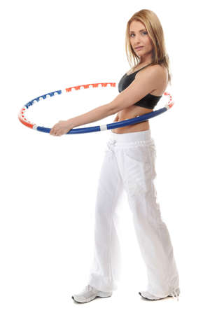 Full length young sporty girl doing exercise with hula hoop. Fitness woman isolated on white photo