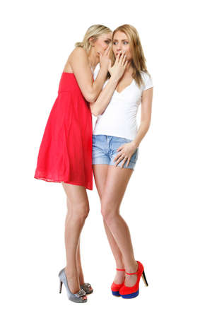 Gossip rumour - two women in full length. Woman telling secrets to your girlfriend, secrets spreading over white background