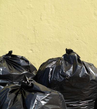 Pile of full black garbage bags outdoor photo
