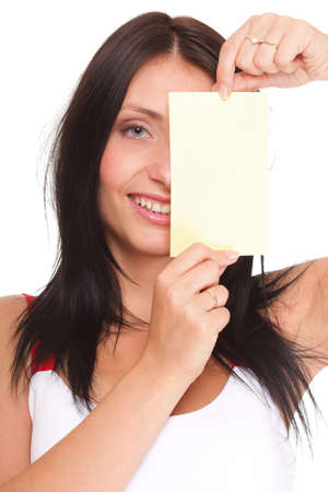 Excited woman showing empty blank paper card photo