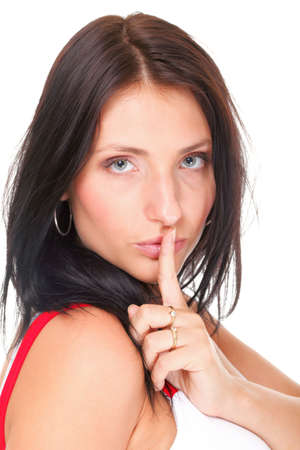 voiceless: Woman making a keep quiet gesture putting her finger on mouth isolated