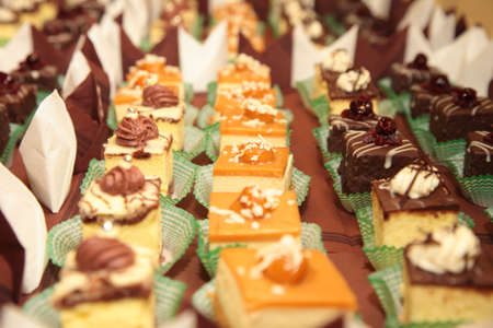 Varieties of cakes individual decorative desserts on the table at a luxury event, gourmet catering sweets Stock Photo - 19927243