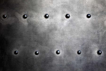 Noir plaque de m�tal, grunge ou texture d'armure avec des rivets comme toile de fond