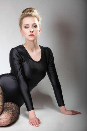 modern style beautiful woman ballet dancer in studio gray background photo