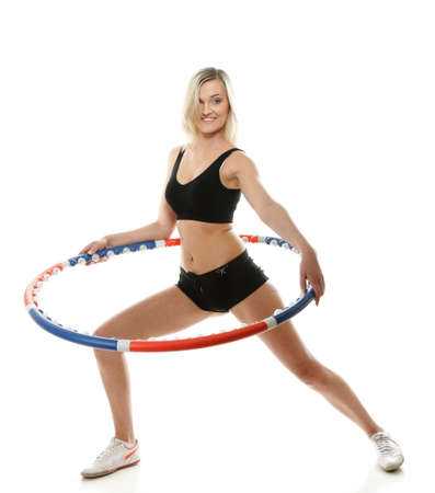 Full length young sporty girl doing exercise with  hoop. Fitness woman isolated on white photo