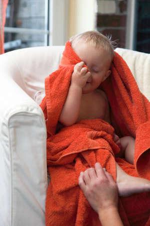 Adorable happy baby boy in colorful bath towel indoor Stock Photo - 20128026
