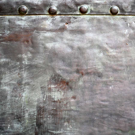 stell: Black grunge metal plate or armour texture with rivets as background Stock Photo