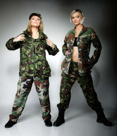 Full length two women in military clothes army girls on gray background. photo