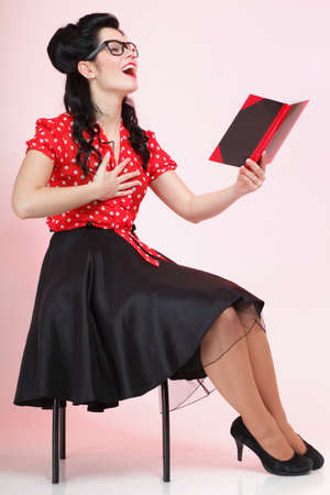 Portrait of a young woman, college student or teacher notebook in hand, full body photo