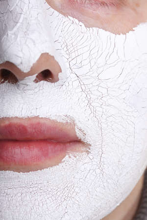 Mature woman with facial Mask. Spa photo