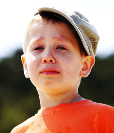 lonely boy: Portrait of crying unhappy little boy outdoor Stock Photo