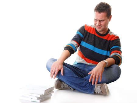 Exhausted and tired student with pile of books on white background photo