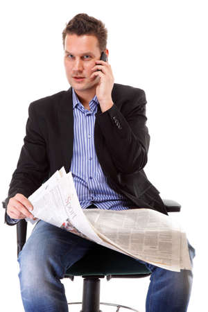young businessman reads newspaper while phoning  job seeking white background photo