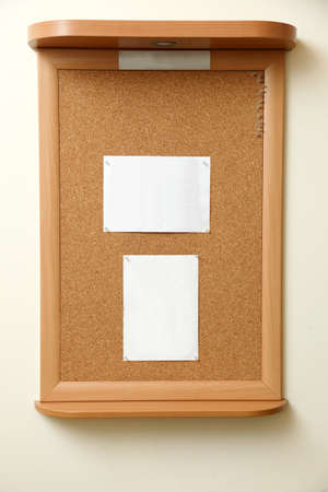 cork board: note paper pined on brown cork board background Stock Photo