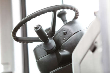 Steering wheel in interior of a new industrial machine photo
