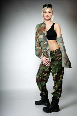 full length woman: Full length woman in military clothes army girl on gray background.