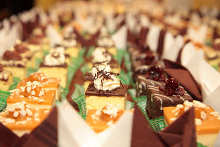 holiday catering: Varieties of cakes individual decorative desserts on the table at a luxury event, gourmet catering sweets Stock Photo