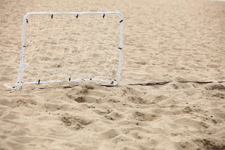 football gate on sandy beach soccer goal photo