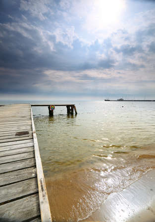 old wooden empty pier jetty at the sea sunrise or sunset - Sopot Poland photo