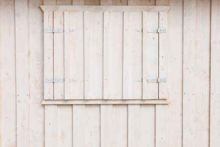 beach window: Wooden building house on beach. Window on wooden white house wood background Stock Photo