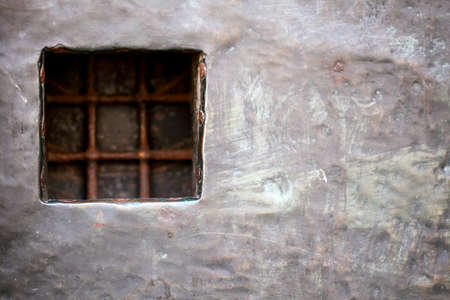 stell: cell window with stell lattice in grey grunge metal pirson wall door as background