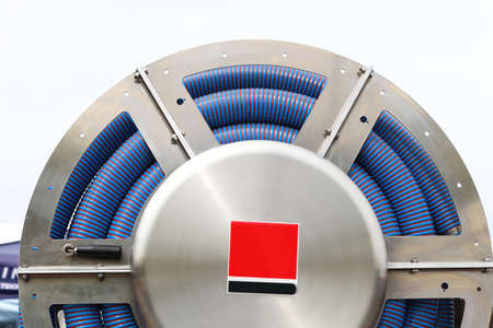vulcanization: rolled up of blue plastic hose industrial detail