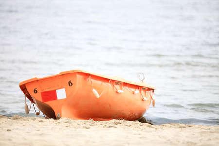 buoyancy: Beach life-saving. Lifeguard rescue equipment orange preserver tool boat, buoyancy aid