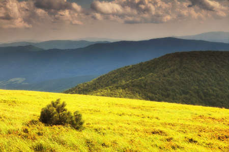 Hills beautiful summer landscape in the mountains dark sky with clouds Bieszczady Poland photo