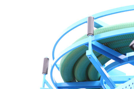 hosepipe: rolled up of green plastic hose industrial detail white background