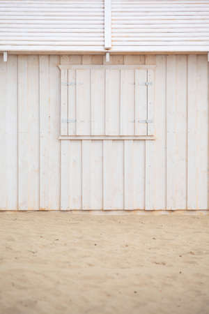 beach window: Wooden building house on beach. Window on wooden white house