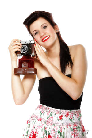 pretty retro summer girl taking picture using vintage camera white background photo