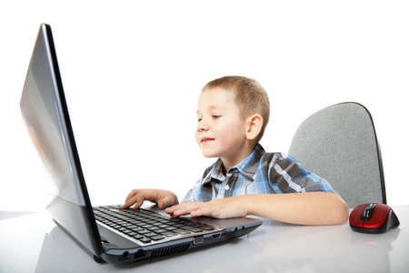 Computer addiction child boy with laptop notebook white background photo