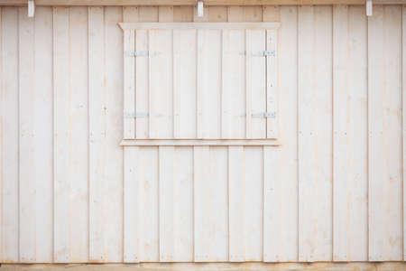 Wooden building house on beach. Window on wooden white house wood background photo
