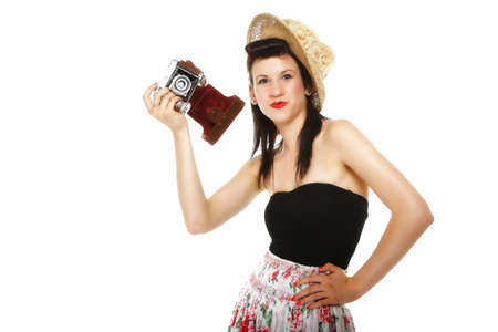 pretty retro summer girl in hat taking picture using vintage camera white background photo