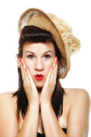 surprised woman face, beautiful girl in hat retro style holding her head in amazement isolated on white background photo