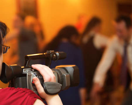 taking video: Covering an event with a video camera. Hand with camera records taking video Stock Photo
