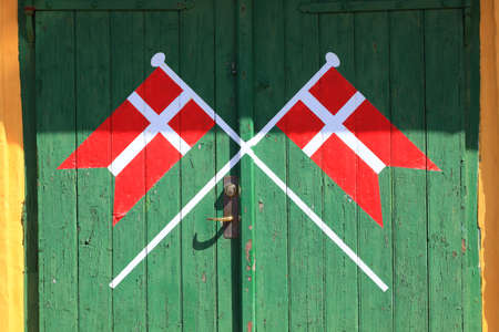 denmark, danish flag painted on old wood green door background photo