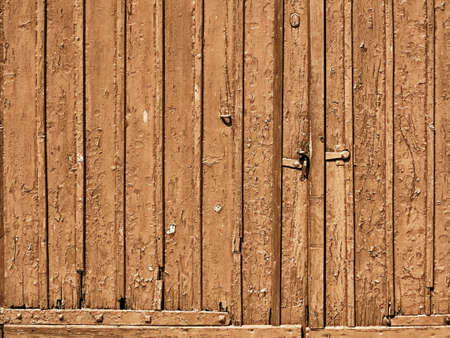 grungy brown doors background of painted wood plank or wooden old aged texture photo