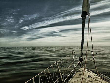 Yachting yacht sailboat sailing in baltic sea at evening summer vacation. Tourism luxury lifestyle. Sepia toned photo