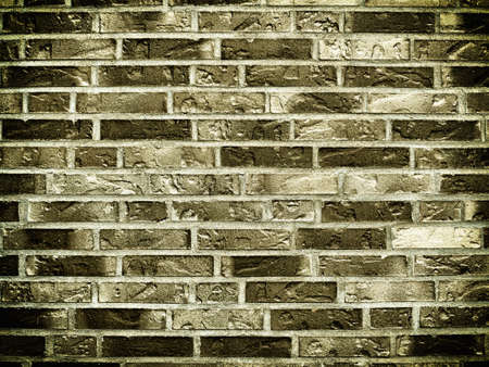 Old brick wall texture pattern grunge background with vignette sepia toned photo