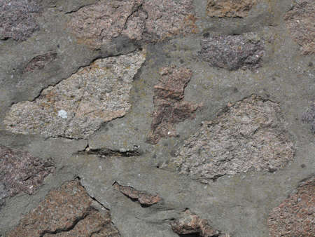 Background of natural stone rock wall texture or cobblestone pavement detail Stock Photo - 22000043