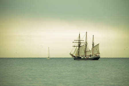 Beautiful tall sailing ship on sea at dusk sunset  sunrise photo