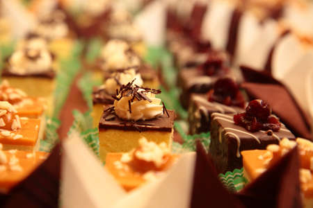 Varieties of cakes individual decorative desserts on the table at a luxury event, gourmet catering sweets Stock Photo - 21868905